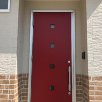 ローコスト住宅山口防府の玄関、赤いドア